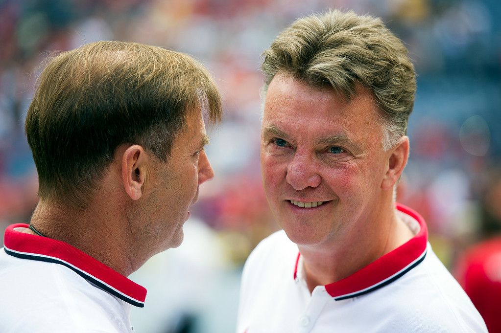 . Manchester United manager Louis van Gaal greets United goalkeeping coach Frans Hoek on the sidelines before an exhibition match against AS Roma during the Guinness International Champions Cup at Sports Authority Field at Mile High on July 26, 2014, in Denver, Colorado. Manchester United won 3-2. (Photo by Daniel Petty/The Denver Post)