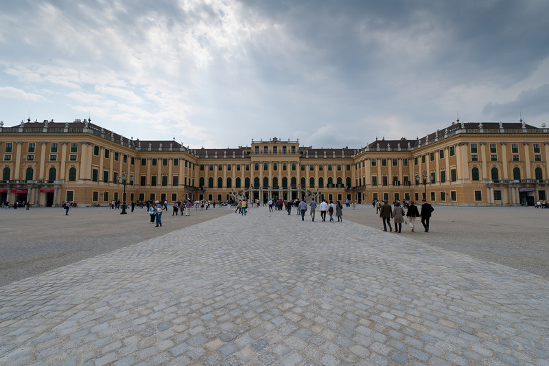 The grounds of Schonbrunn Palace filled with tourists - Vienna, Austria