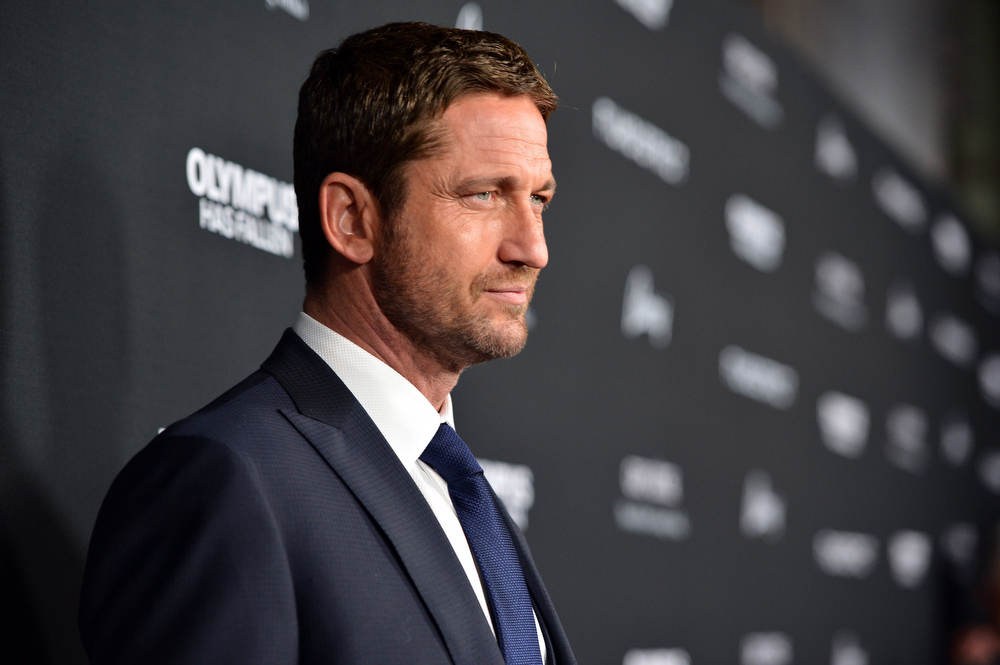 """. Actor Gerard Butler arrives at the premiere of FilmDistrict\'s \""""Olympus Has Fallen\"""" at ArcLight Cinemas Cinerama Dome on March 18, 2013 in Hollywood, California.  (Photo by Alberto E. Rodriguez/Getty Images)"""