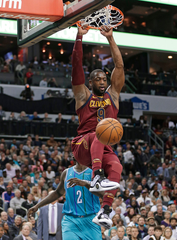 . Cleveland Cavaliers\' Dwyane Wade (9) dunks against the Charlotte Hornets during the second half of an NBA basketball game in Charlotte, N.C., Wednesday, Nov. 15, 2017. (AP Photo/Chuck Burton)