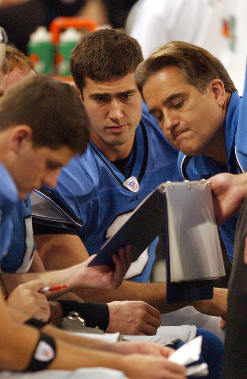 . Detroit Lions\' back-up QB Joey Harrington, center, and head coach Steve Mariucci,right, review plays with QB starter Jeff  Garcia (not in photo) during play against the Chicago Bears during the first half at Ford Field in Detroit. Photographed Sunday, Oct. 30, 2005. The Lions lost 19-13 in overtime to Chicago.