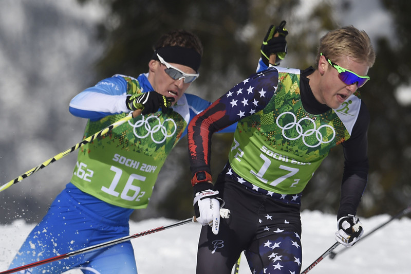 . Finland\'s Sami Jauhojaervi (L) and US Erik Bjornsen compete in the Men\'s Cross-Country Skiing Team Sprint Classic Semifinals at the Laura Cross-Country Ski and Biathlon Center during the Sochi Winter Olympics on February 19, 2014 in Rosa Khutor near Sochi. (ODD ANDERSEN/AFP/Getty Images)