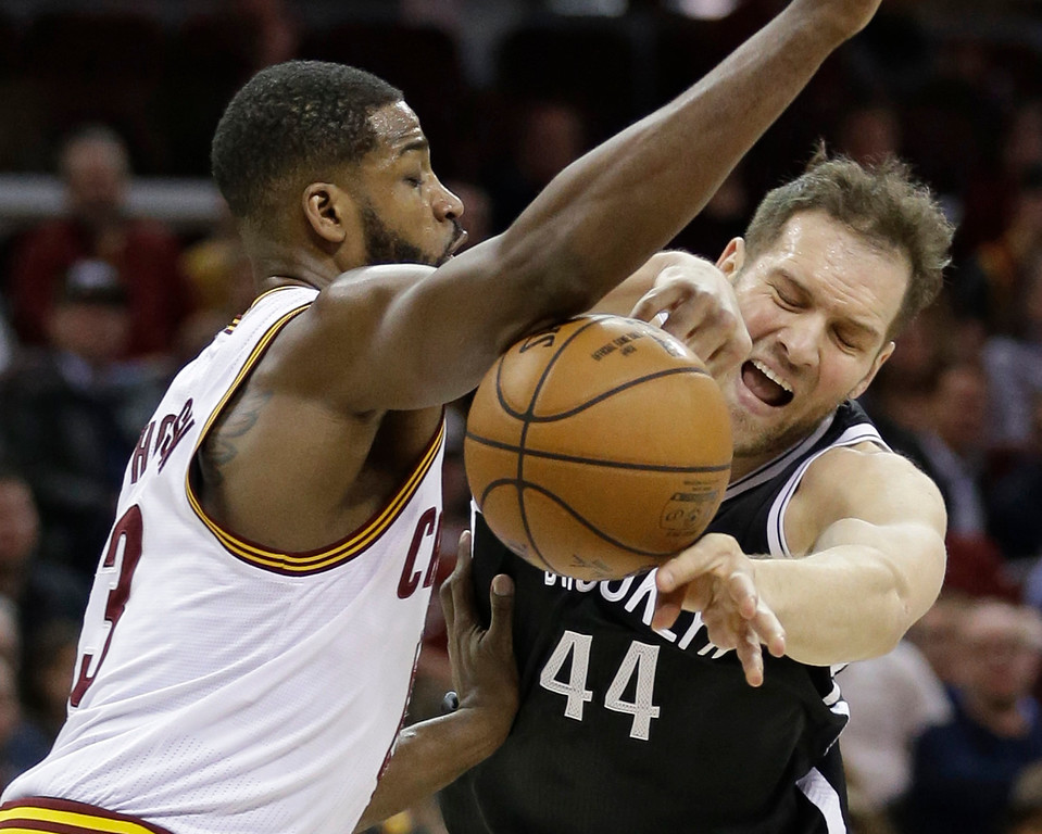 . Brooklyn Nets\' Bojan Bogdanovic (44) passes the ball past Cleveland Cavaliers\' Tristan Thompson (13) during the first half of an NBA basketball game, Friday, Jan. 27, 2017, in Cleveland. (AP Photo/Tony Dejak)