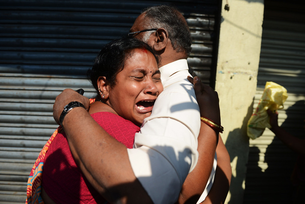 . Relatives of those killed in a bus accident react after receiving news from police outside the private bus operator\'s office in Hyderabad on October 30, 2013. AFP PHOTO / Noah SEELAM/AFP/Getty Images