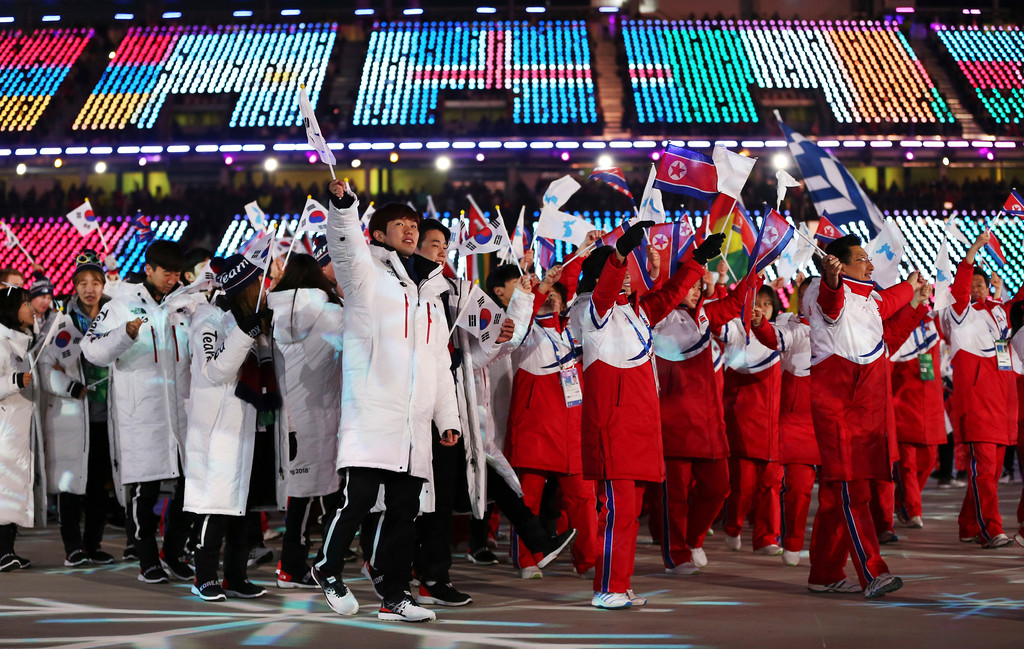 . North and South Koreans wave flags during the closing ceremony of the 2018 Winter Olympics in Pyeongchang, South Korea, Sunday, Feb. 25, 2018. (AP Photo/Natacha Pisarenko)