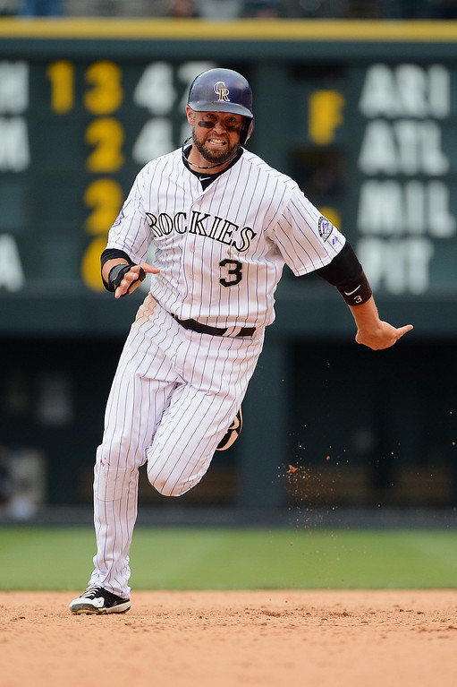 . Michael Cuddyer #3 of the Colorado Rockies runs towards third base in the eighth inning of the game against the San Francisco Giants at Coors Field on June 30, 2013 in Denver, Colorado.  (Photo by Garrett W. Ellwood/Getty Images)