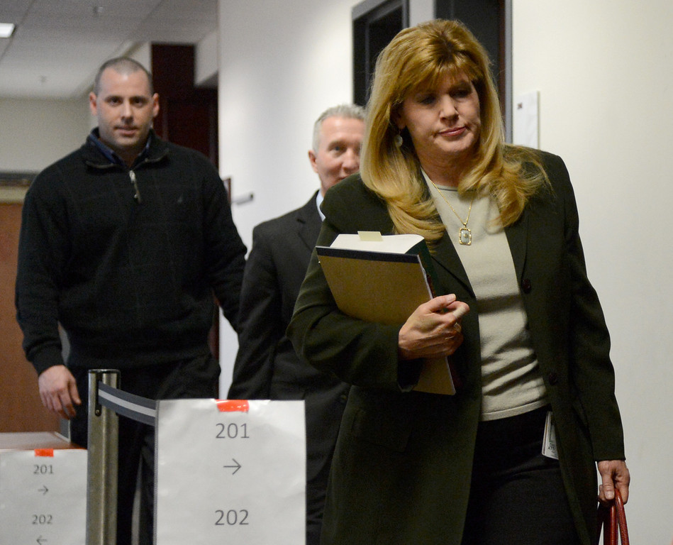 . CENTENNIAL, CO - JANUARY 11: Prosecutor Karen Pearson leaves the courtroom, of the Arapahoe County Courthouse, Friday, January 11, 2013. The  arraignment for Aurora theater shooting suspect James Holmes  was postponed until March 2013 for the July 20 shooting at the Century 16 theater that killed 12 people and injured 70 others.
