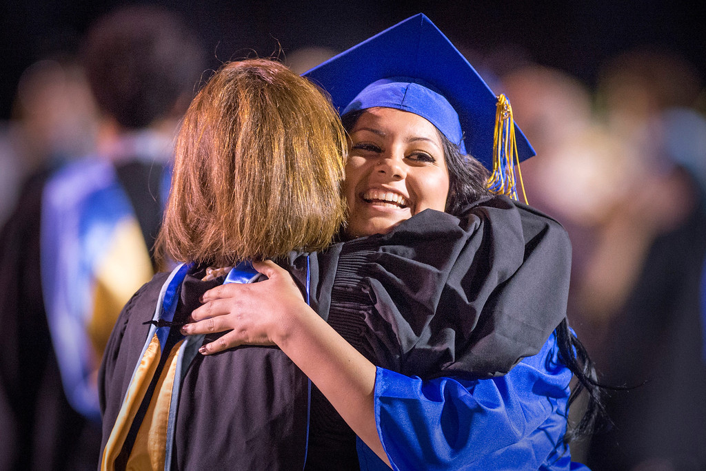 . Jennifer Mata hugs one of her teachers after receiving her diploma during California High graduation at their Whittier campus stadium June 13, 2013.   (SGVN staff photo by Leo Jarzomb)