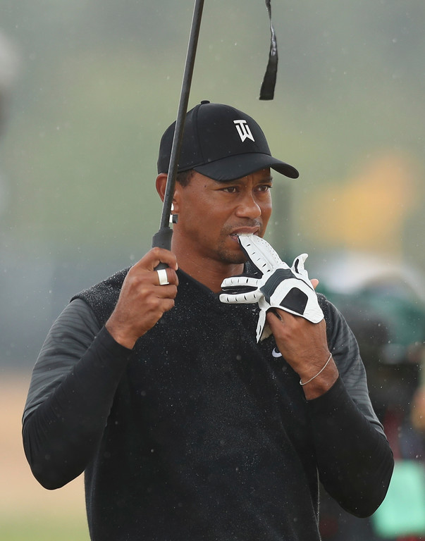 . Tiger Woods of the US takes off his glove after playing out of the rough on the 7th hole during the second round of the British Open Golf Championship in Carnoustie, Scotland, Friday July 20, 2018. (AP Photo/Jon Super)