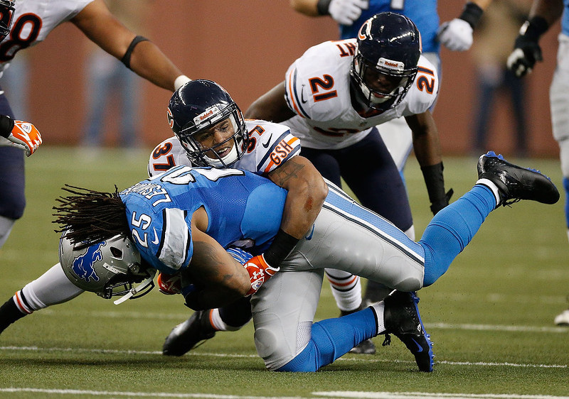 . Anthony Walters #37 of the Chicago Bears tackles Mikel Leshoure #25 of the Detroit Lions during the fourth quarter at Ford Field on December 30, 2012 in Detroit, Michigan. Chicago won the game 26-24. (Photo by Gregory Shamus/Getty Images)