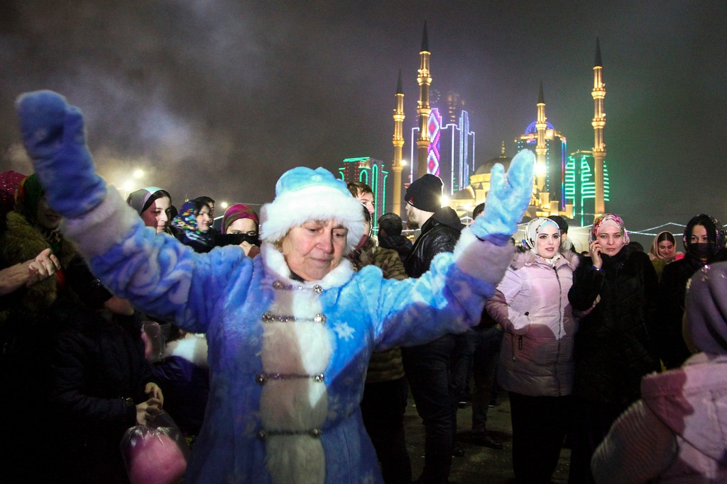 . A woman dances during New Year\'s celebrations in the center of Grozny, the capital of Chechnya, Russia, Monday, Jan. 1, 2018. (AP Photo/Musa Sadulayev)