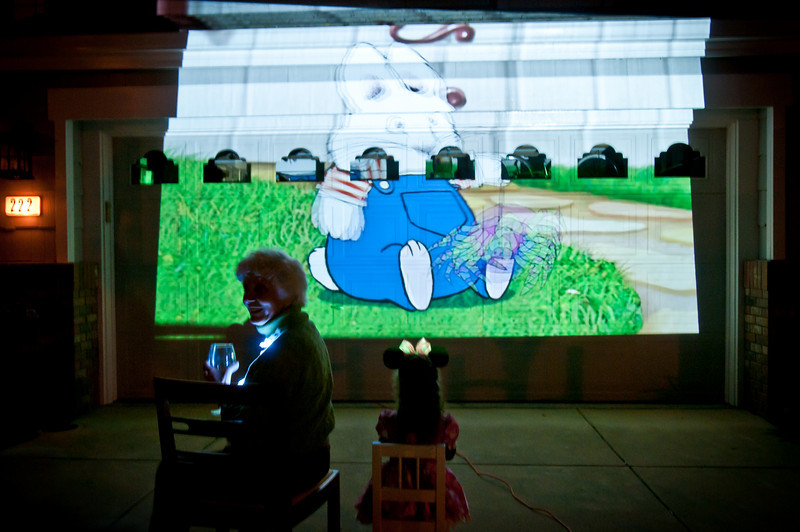 Uncle Andy setup a giant movie projector on the garage door and they picked Olivia's favorite movie. She sat outside and watched for a while with her other Gramma!
