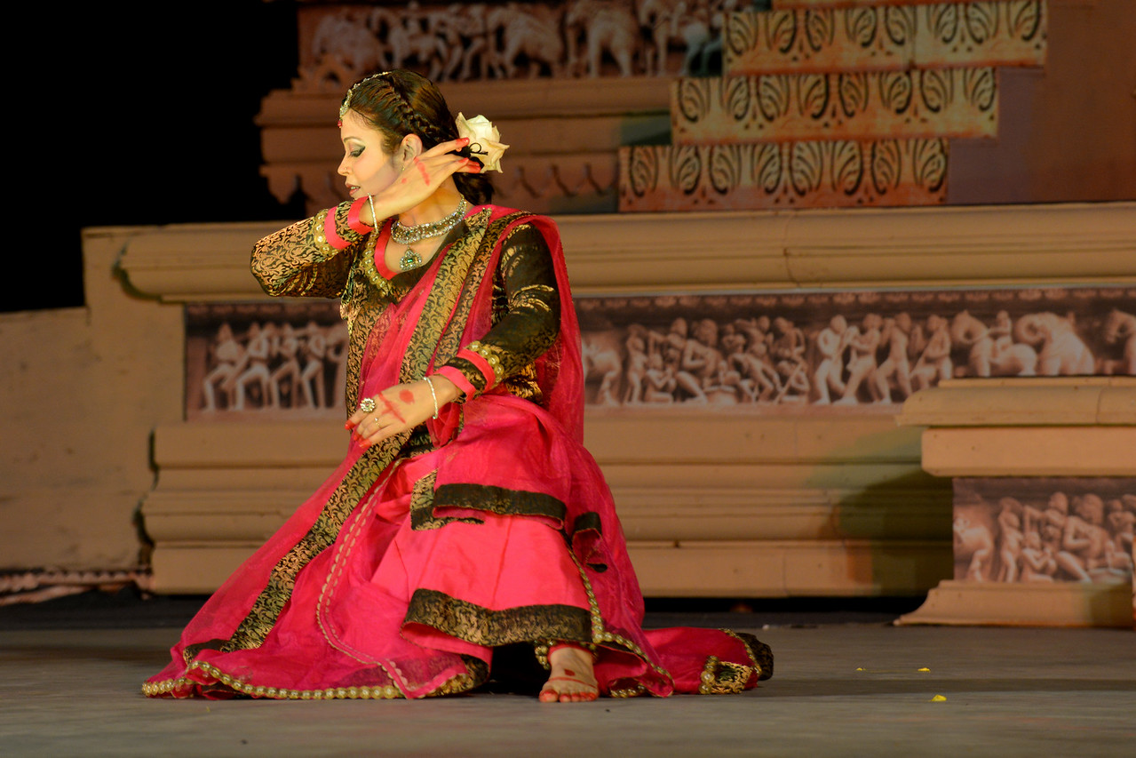 """Kathak & Uzbek dance performance by Samiksha Sharma, Dhirendra Tiwari, and Diyor Aliev at the Khajuraho Festival of Dances February, 2014.<br /> <br /> Khajuraho Festival of Dances is celebrated at a time when the hardness of winter begins to fade and the king of all seasons, spring, takes over. The most colorful and brilliant classical dance forms of India with their roots in the ling and rich cultural traditions across the country, offer a feast for the eyes during a weeklong extravaganza.<br /> <br /> Khajuraho is located in the Indian state of Madhya Pradesh and roughly 620 kilometers (385 miles) southeast of New Delhi, the temples of Khajuraho are famous for their so-called """"erotic sculptures"""". Khajuraho was the cultural capital of the Chandela Rajputs, a Hindu dynasty that ruled from the 10th to 12th centuries."""