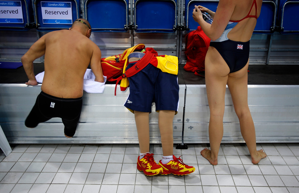 . In this Aug. 31, 2012 file photo, Spain\'s Xabi Torres jumps next to his prosthesis as he leaves the swimming pool after training ahead of the competition at the 2012 Paralympics Olympics in London. (AP Photo/Emilio Morenatti, File)