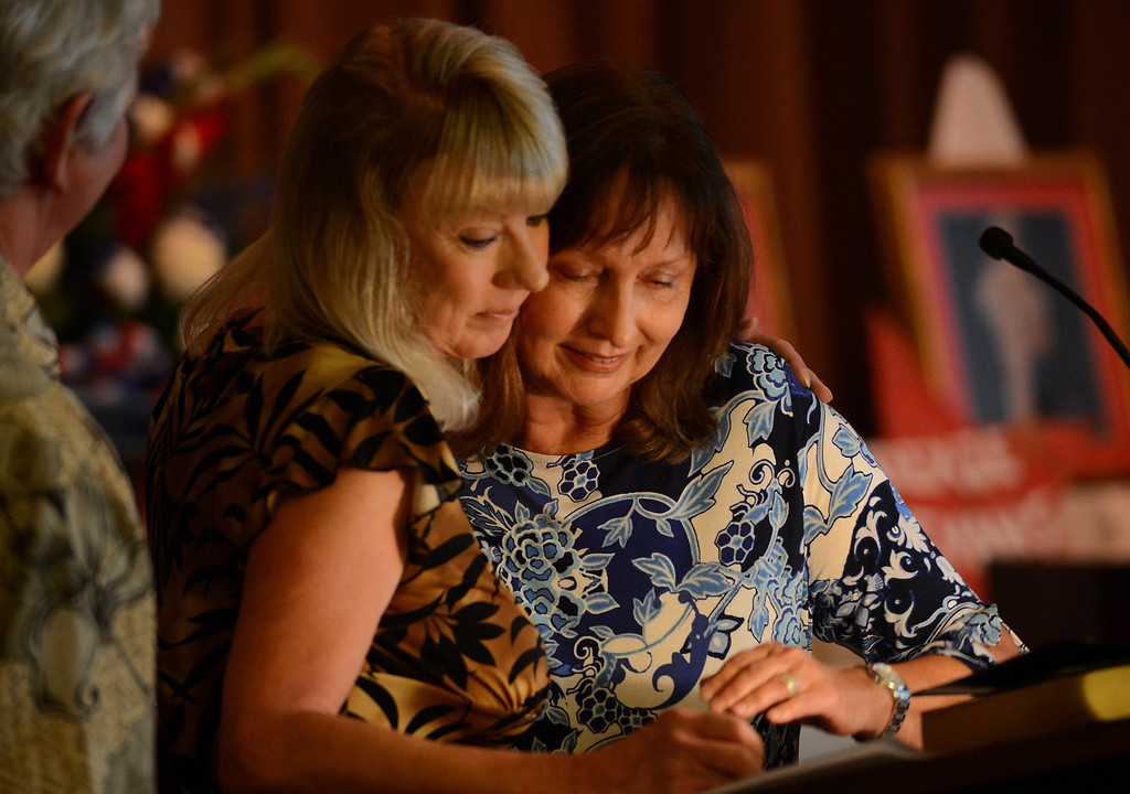 . Dixie\'s neices Cherie Turner, of San Clemente, and Carol Anderson, of Thousand Oaks, embrace while talking about their aunt during a memorial service for Dixie Evans Sunday, September 1, 2013, at Palm Mortuary in Las Vegas. Jennifer Cappuccio Maher/Inland Valley Daily Bulletin
