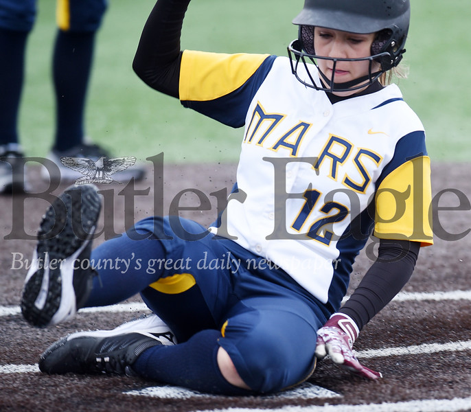 Harold Aughton/Butler Eagle: After getting hit by a pitch, Mars Alaina Taylor, steals home after a wild pitch.