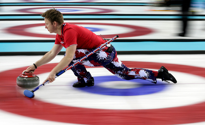 . Norway\'s Torger Nergaard delivers the rock during the men\'s curling competition against Russia at the 2014 Winter Olympics, Tuesday, Feb. 11, 2014, in Sochi, Russia. (AP Photo/Wong Maye-E)