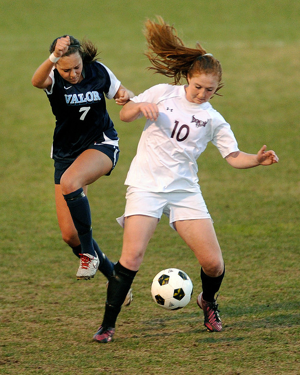 . PARKER, CO. - APRIL 2: Valor senior defender Brooke Sewell (7) challenged Demons forward Mariah Fluitt (10) for the ball in the second half. The Valor Christian High School girl\'s soccer team defeated Golden 4-1 Wednesday night, April 3, 2013.  Photo By Karl Gehring/The Denver Post)