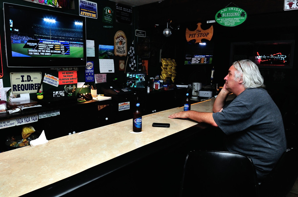 . Tim Grobaty enjoying a beer at his new neighborhood watering hole, Chuckles and Fern\'s Pit Stop.Photo by Thomas Wasper for the Press Telegram