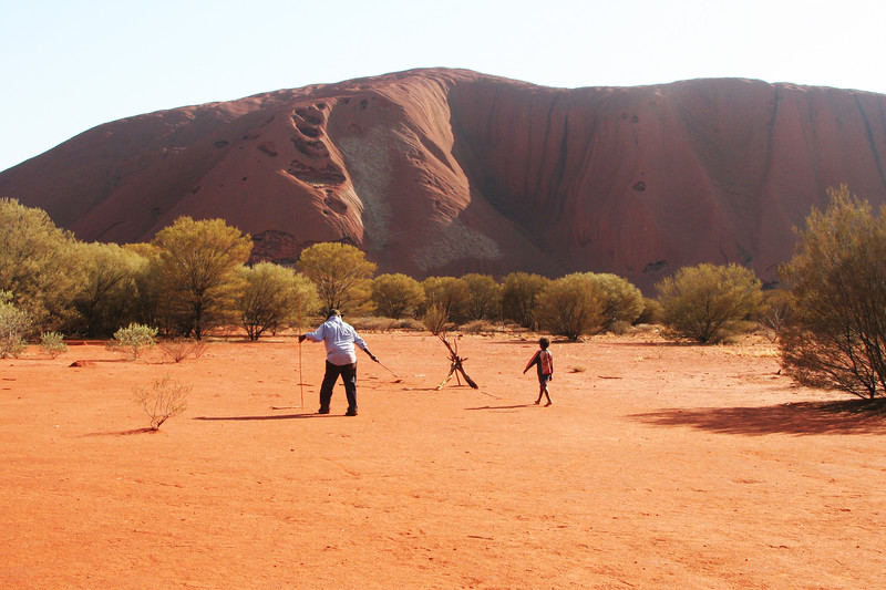 Park guide and boy with Uluru in behind, Australia, 2006