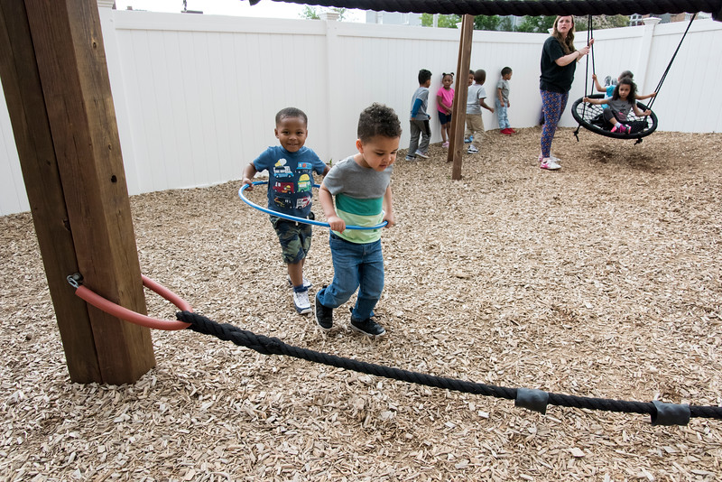 05/20/19  Wesley Bunnell | Staff  Mason Holmes, L, and his classmate share a hole hoop during playtime at the New Britain YMCA School Readiness program for children ages 3-5.