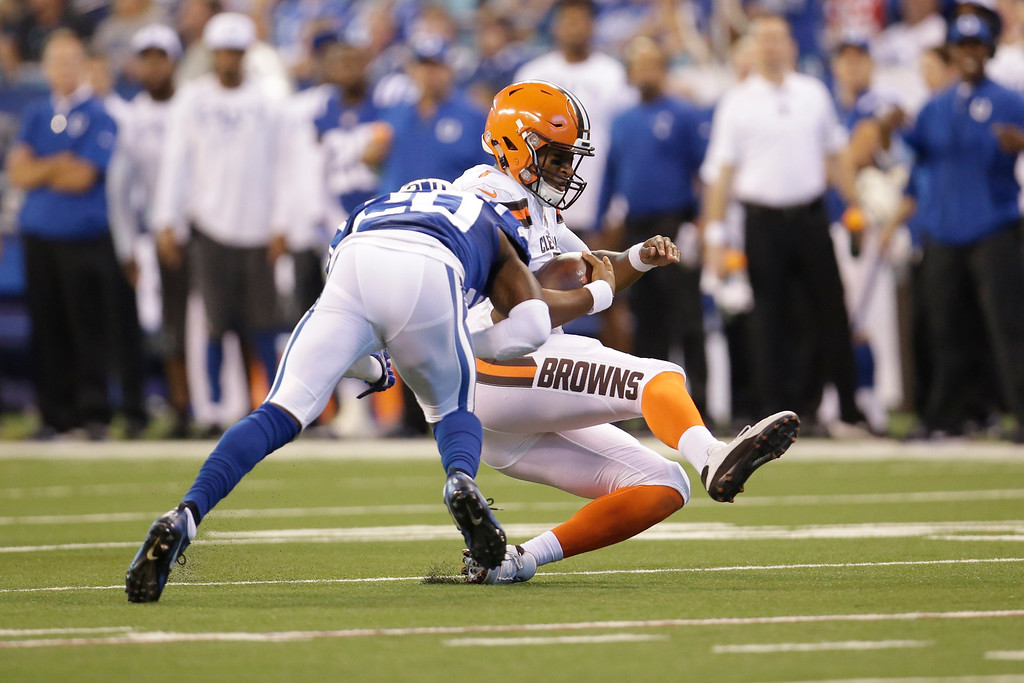 . Cleveland Browns quarterback DeShone Kizer (7) is hit by Indianapolis Colts free safety Darius Butler (20) as he slides during the second half of an NFL football game in Indianapolis, Sunday, Sept. 24, 2017. (AP Photo/AJ Mast)