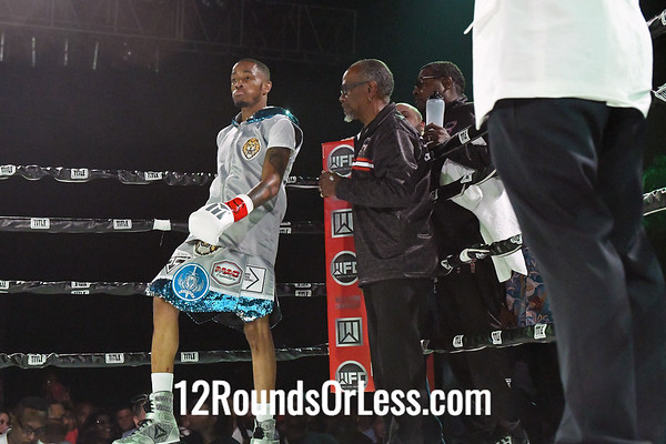 Bout #9:   Ryizeemmion Ford (Red Wrist Wraps)   vs   Michael Russel (Blue Wrist Wraps), 130 Lbs., 4 Rounds