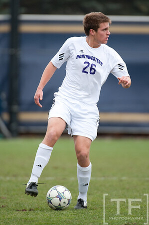 Nov 13, 2011; Ann Arbor, MI, USA; Northwestern Wildcats midfielder Grant Wilson (26) takes the ball up field in the first half against the Penn State Nittany Lions at the final game of the 2011 Big Ten Championship at Michigan Soccer Stadium. Mandatory Credit: Tim Fuller-US PRESSWIRE