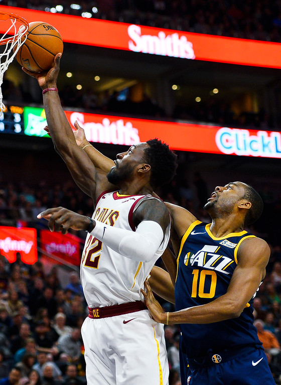 . Cleveland Cavaliers forward Jeff Green (32) attempts a shot under Utah Jazz guard Alec Burks (10) in the first half of an NBA basketball game Saturday, Dec. 30, 2017, in Salt Lake City. (AP Photo/Alex Goodlett)