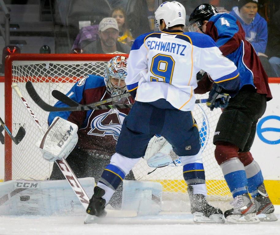 . Colorado goalie Semyon Varlamov (1) was pressured by St. Louis wing Jaden Schwartz (9) in the first period.  Photo By Karl Gehring/The Denver Post