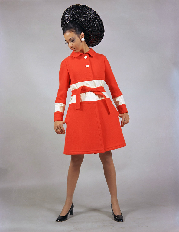 . A morning coat of lacquer-red wool, with white inlays at the waistline and the cuffs, worn with a very large and high black straw hat, a creation by the Tita Rossi fashion house of Rome, Jan. 14, 1969, to be presented at the Rome show of Italian spring and summer fashions which will open on January 17. (AP Photo/Mario Torrisi)