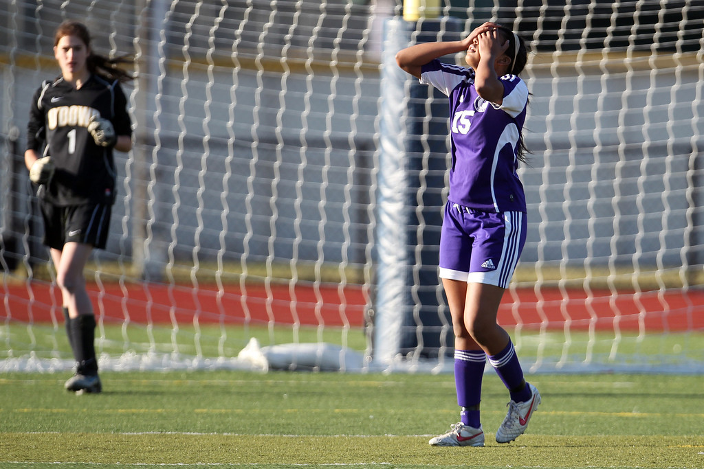 . Piedmont\'s Lindsey Vaughn (15) reacts after missing her penalty kick against Bishop O\'Dowd goalie Lorna McElrath (1) in the North Coast Section Division II Girls Soccer Championship at Dublin High School soccer field in Dublin, Calif., on Saturday, Feb. 23, 2013. Bishop O\'Dowd won 3-2 in a series of penalty kicks. (Ray Chavez/Staff)