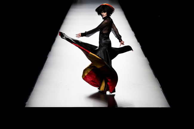 Description of . A model displays an Autumn/Winter design by Francis Montesinos during Madrid's Fashion Week, in Madrid, Monday, Feb. 18, 2013. (AP Photo/Daniel Ochoa De Olza)