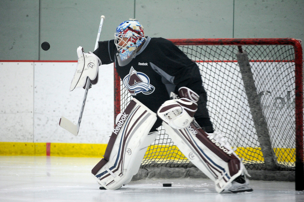. Colorado Avalanche G J.S. Giguere makes a save during practice  as the Avalanche return to the ice Sunday, January 13, 2013 at Family Sports Center to start the 2013 training camp.  John Leyba, The Denver Post