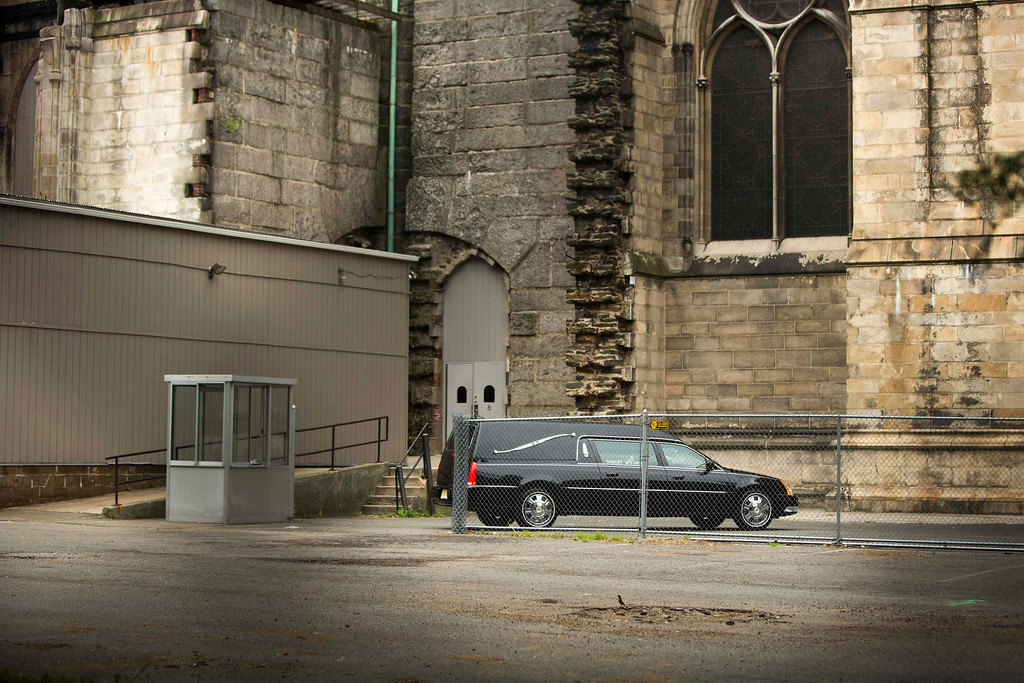 . A hearse arrives outside the Cathedral Church of Saint John the Divine for the funeral services of James Gandolfini, in New York June 27, 2013.  REUTERS/Lucas Jackson
