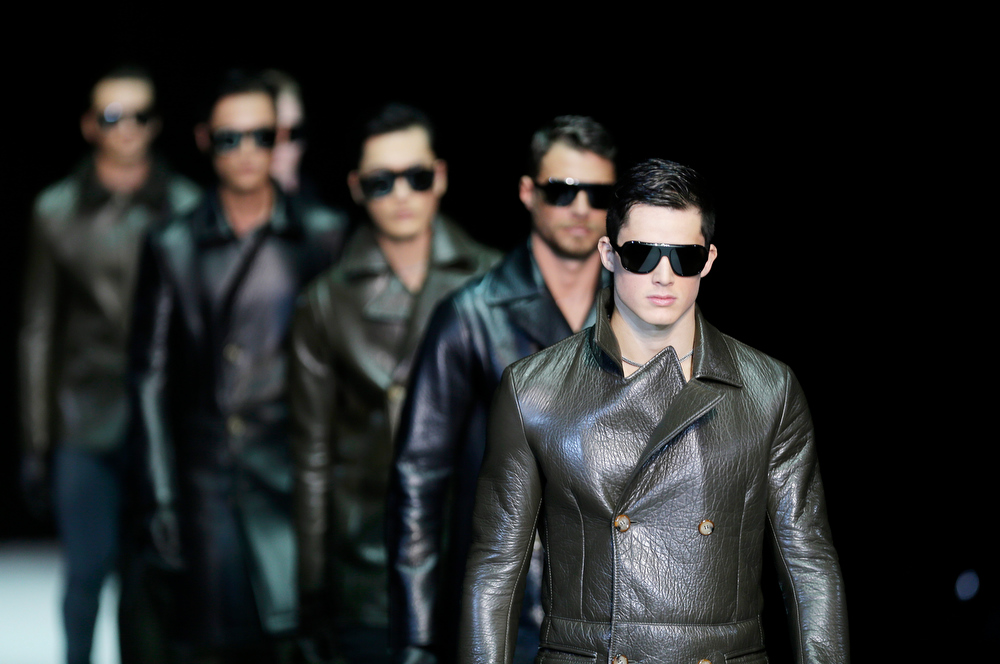 Description of . Models wear creations for Emporio Armani men's Fall-Winter 2013-14 collection, part of the Milan Fashion Week, unveiled in Milan, Italy, Monday, Jan. 14, 2013. (AP Photo/Antonio Calanni)