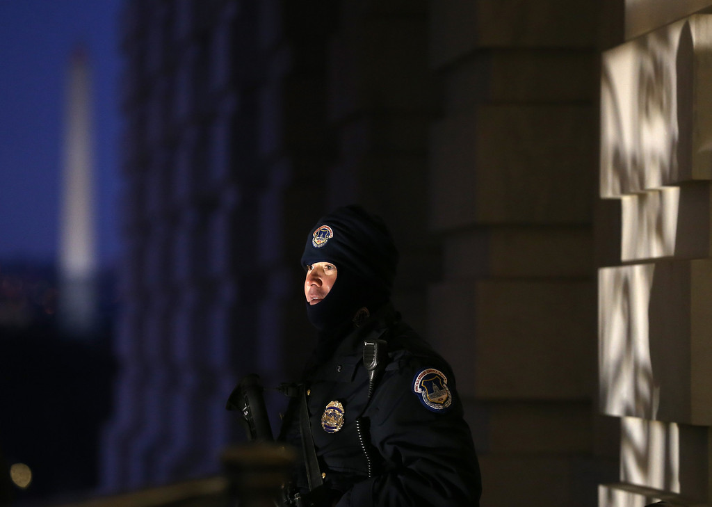 . WASHINGTON, DC - JANUARY 28: A U.S. Capitol Police officer stands gurad in the cold before President Barack Obama\'s State of the Union address before a joint session of Congress, on January 28, 2014 in Washington, DC. In his fifth State of the Union address, Obama is expected to emphasize on healthcare, economic fairness and new initiatives designed to stimulate the U.S. economy with bipartisan cooperation.  (Photo by Mark Wilson/Getty Images)