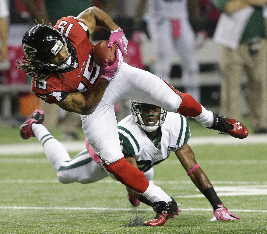 . Atlanta Falcons wide receiver Kevin Cone (15) moves the ball against New York Jets cornerback Antonio Cromartie (31) during the second half of an NFL football game, Monday, Oct. 7, 2013, in Atlanta. (AP Photo/John Bazemore)