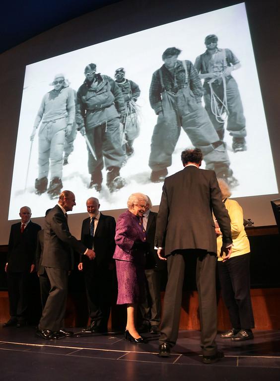 . Britain\'s Queen Elizabeth II (C) and Prince Philip, Duke of Edinburgh (2L) attend a reception to celebrate the 60th Anniversary of the first ascent of Mount Everest in 1953, at the Royal Geographical Society in Kensington, west London on May 29, 2013. Nepalese sherpa Tenzing Norgay and New Zealand mountaineer Edmund Hillary conquered the summit of Mount Everest in a British-funded expedition in 1953.  AFP PHOTO / POOL / YUI MOKYUI MOK/AFP/Getty Images