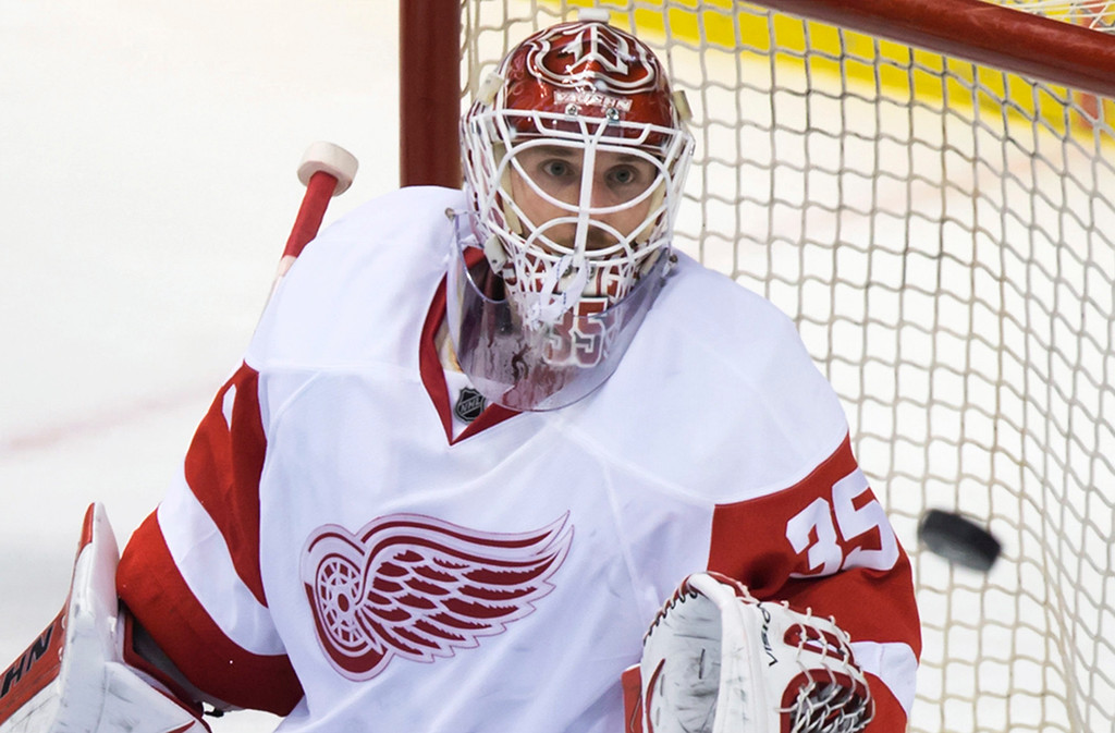. Detroit Red Wings goalie Jimmy Howard watches the puck after it was deflected wide of the net during the second period of an NHL hockey game in Vancouver, British Columbia on Saturday, Jan. 3, 2015. (AP Photo/The Canadian Press, Darryl Dyck)