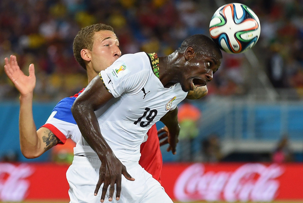 Description of . Ghana's defender Jonathan Mensah (R) heads the ball in front of US defender Fabian Johnson during a Group G football match between Ghana and US at the Dunas Arena in Natal during the 2014 FIFA World Cup on June 16, 2014.   AFP PHOTO / EMMANUEL DUNANDEMMANUEL DUNAND/AFP/Getty Images