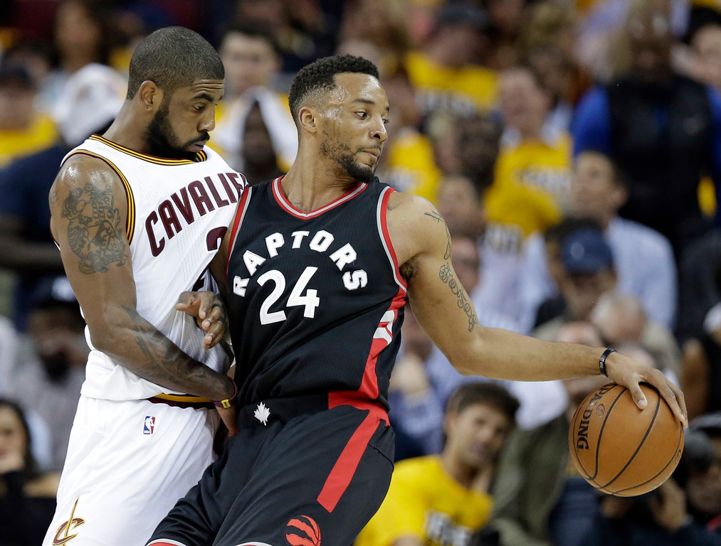 . Toronto Raptors\' Norman Powell (24) is stopped by Cleveland Cavaliers\' Kyrie Irving (2) in the second half in Game 1 of a second-round NBA basketball playoff series, Monday, May 1, 2017, in Cleveland. The Cavaliers won 116-105. (AP Photo/Tony Dejak)