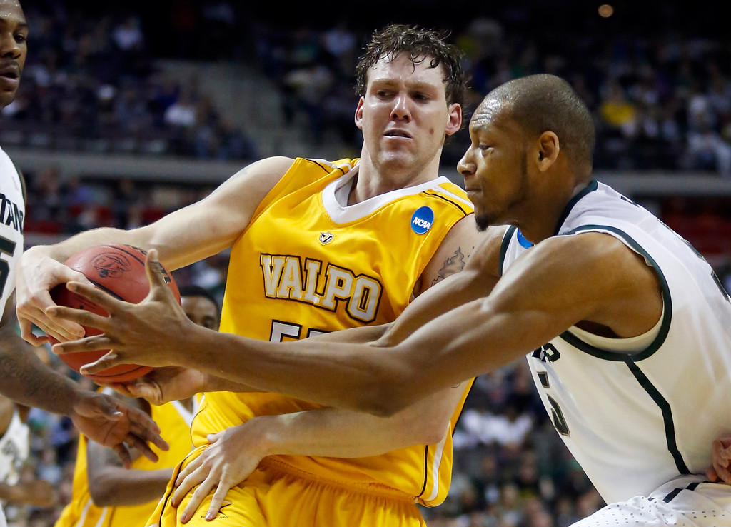 . Valparaiso forward Kevin Van Wijk, left, steals the ball from Michigan State forward Adreian Payne, right, in the first half of a second-round game of the NCAA college basketball tournament Thursday, March 21, 2013, in Auburn Hills, Mich. (AP Photo/Duane Burleson)