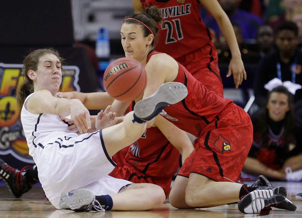 . Connecticut forward Breanna Stewart (30) and Louisville guard Megan Deines (15) battle for a loose ball during first half of the national championship game of the women\'s Final Four of the NCAA college basketball tournament, Tuesday, April 9, 2013, in New Orleans. (AP Photo/Gerald Herbert)