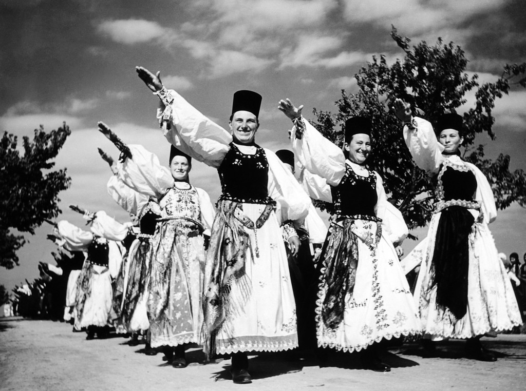 . Some of the 800,000 Germans who live in Romania?s mountain areas. The Hungarians imported them at intervals for 700 years from the Rhineland and Saxon to do skilled manual work and fight off the barbarians. They still speak old German and are Luterans. The men and women are not giving the Nazi salute but the Roman salute of a new government co-operative in Mercurea Sibiu, on Jan. 24, 1939. (AP Photo)