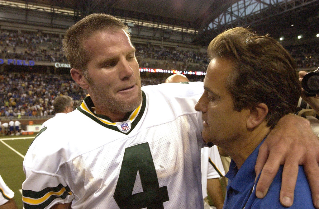 . Green Bay Packers at Detroit Lions.  Lions head coach Steve Mariucci (right) and Packers QB Brett Farve trade well wishes after the game. Lions defeated the Packers 17-3.
