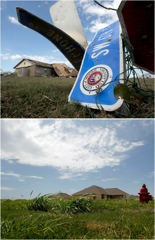 . In this photo combination, a tornado-ravaged home stands in the distance beyond a twisted street sign on May 22, 2013, in Moore, Okla., top, and the lot is cleared and a new homes stand next door on May 8, 2014, bottom. Moore continues to rebuild in the wake of a massive tornado that tore through Oklahoma City suburb on May 20, 2013. (AP Photo/Charlie Riedel)