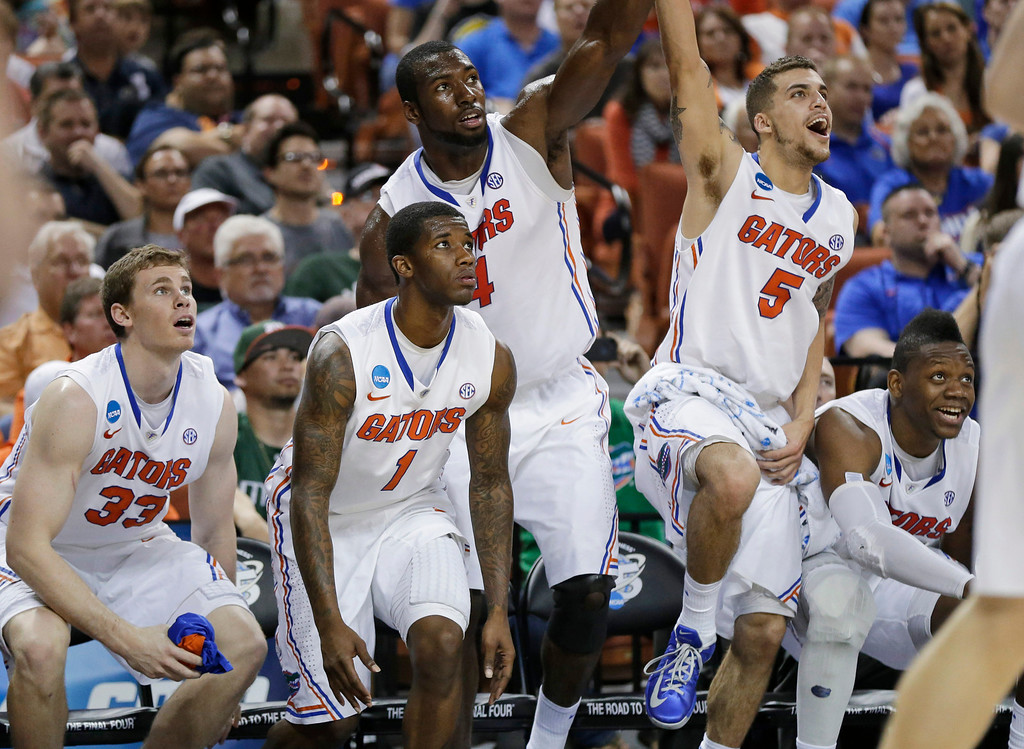 . Florida\'s Erik Murphy (33), Kenny Boynton (1), Patric Young (4), Scottie Wilbekin (5) and Will Yeguete, right, watch on the bench during the final seconds of a second-round game of the NCAA men\'s college basketball tournament Friday, March 22, 2013, in Austin, Texas. Florida defeated Northwestern State 79-47. (AP Photo/Eric Gay)