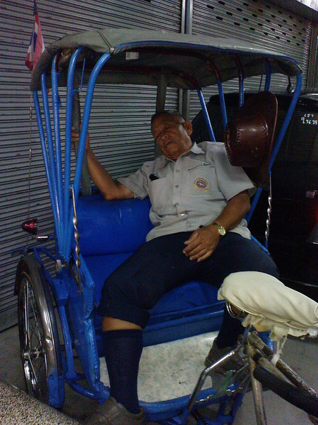 A cyclo driver in Chiang Rai city catching-up on some sleep.