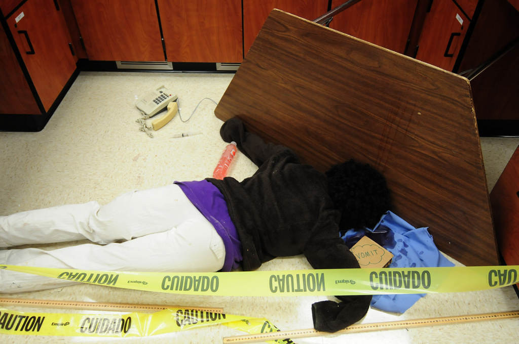 ". Students must solve the mysteries surrounding a ""crime scene\"" inhabited by a \""dead body\"" (an inanimate dummy named Ana Garcia). (Pioneer Press: Scott Takushi)"
